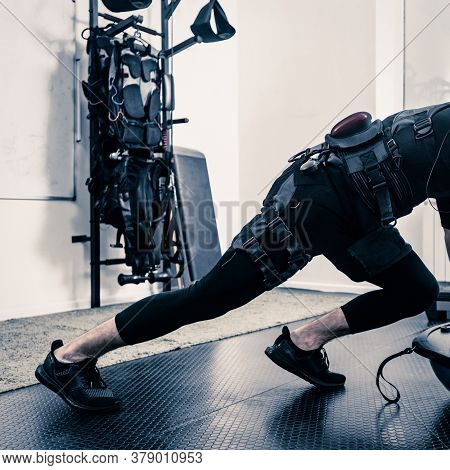 Fitness Athlete In Electrical Muscular Stimulation Suit Doing Push-ups On Bosu Ball