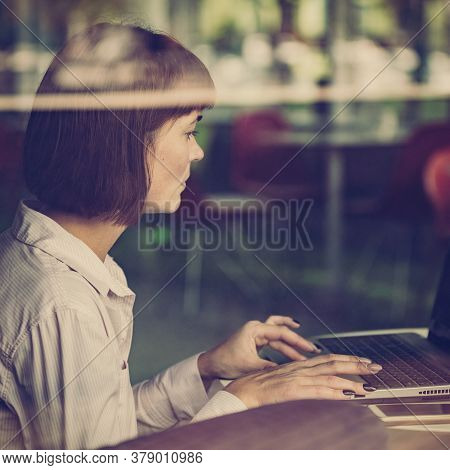 Young Woman Copywriter Using Laptop And Working On Project