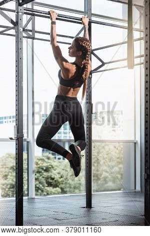 Strong Muscular Woman Doing Pull-up Exercise On Horizontal Bar
