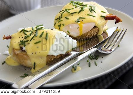 Eggs Benedict- Toasted Muffins, Ham, Poached Eggs, Delicious Buttery Hollandaise Sauce