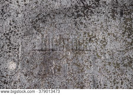 Dirty And Worn Background From An Old Leaky Roofing Material, With A Large Number Of Small Depressio