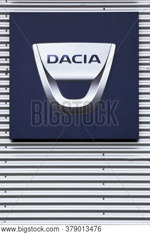 Risskov, Denmark - July 25, 2020: Dacia Logo On Wall Of A Dealer. Dacia Is A Romanian Car Manufactur