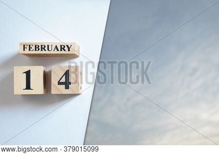 February 14, Blue Sky With Clound With Number Cube.