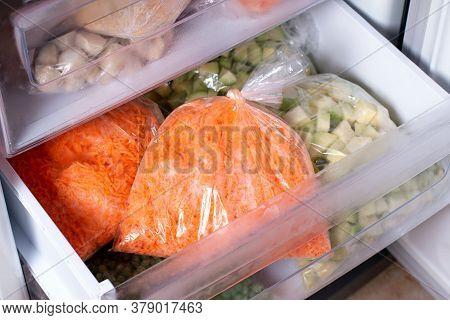 Frozen Vegetables In Bags In Refrigerator, Frozen Carrot, Closeup