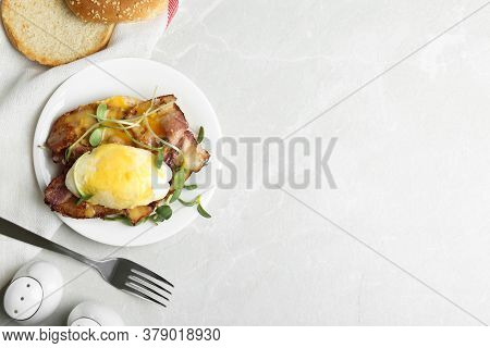 Delicious Egg Benedict Served On Light Grey Marble Table, Flat Lay. Space For Text
