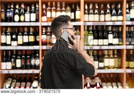 Wholesale And Logistics Concept. Manager Talking On Phone In Store