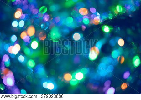 Beautiful Multicolored Bokeh In Purple-blue-green Color As Background Or Wallpapers. Christmas Or Ne