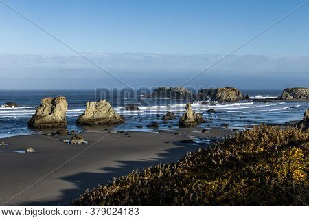 Beautiful Morning In Face Rock State Park, Bandon Oregon With The Sunlight Catching The Waves Adding