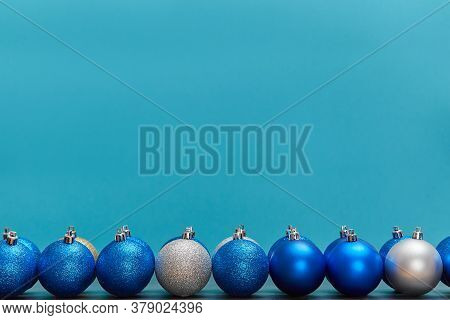 Golden Blue And Silver Balls Isolated On Blue Background. Copy Space. New Year. Christmas Winter Hol