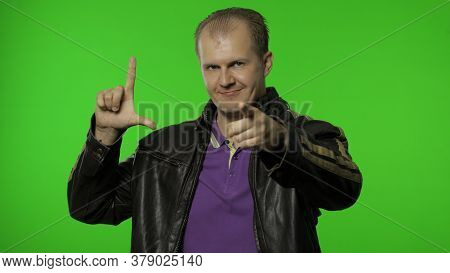 Rocker Man Showing Loser Gesture, Pointing Finger To Camera, Sarcastic Smile, Blaming For Failure, L