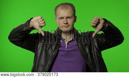 Upset Disappointed Rocker Man Showing Double Thumbs Down, Saying No, Dont Like, Refusing Bad Choice,