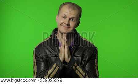 Handsome Rocker Man In Leather Jacket Put Hands In Prayer And Begging, Asking Permission Heartily, L
