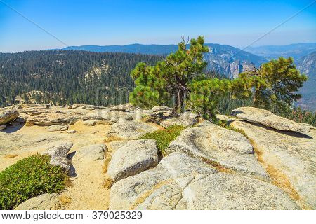Top Of Sentinel Dome, A Granite Dome In The South Wall Of Yosemite Valley. Mountain Hiking In A Summ