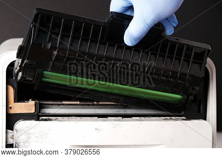 Сoncept Of Refilling, Repairing  Laser Cartridge,  Gloved Hand Pulls  Cartridge Out Of  Printer,old