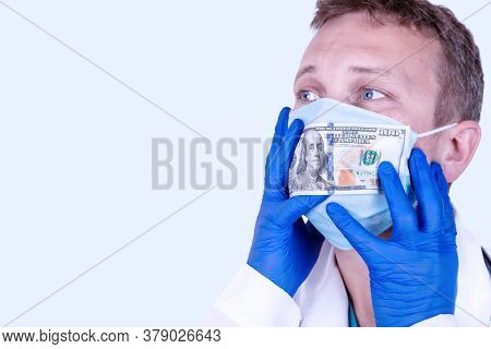 Human Silence, Corruption. Concept. Doctor In A Medical Mask And Money Near The Mouth.