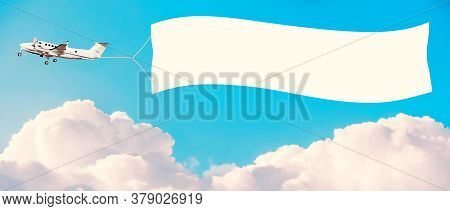 Airplane With White Banner For Advertising Among The Clouds. Tinted Vintage Style. Mockup For Your T