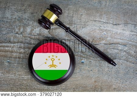 Wooden Judgement Or Auction Mallet With Of Tajikistan Flag. Conceptual Image.