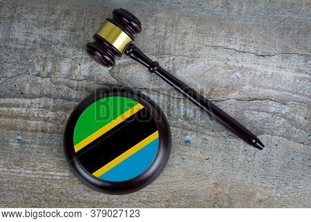 Wooden Judgement Or Auction Mallet With Of Tanzania Flag. Conceptual Image.