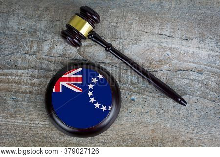 Wooden Judgement Or Auction Mallet With Of Cook Islands Flag. Conceptual Image.