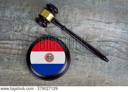 Wooden Judgement Or Auction Mallet With Of Paraguay Flag. Conceptual Image.