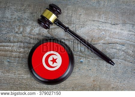 Wooden Judgement Or Auction Mallet With Of Tunisia Flag. Conceptual Image.