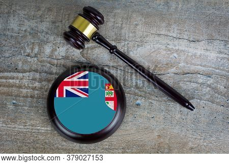 Wooden Judgement Or Auction Mallet With Of Fiji Flag. Conceptual Image.