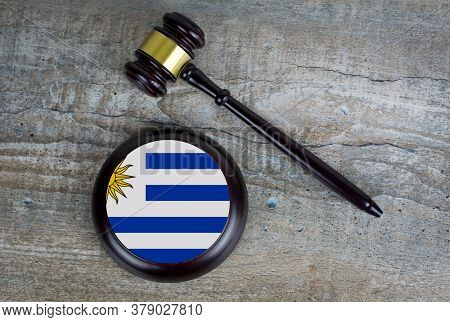 Wooden Judgement Or Auction Mallet With Of Uruguay Flag. Conceptual Image.