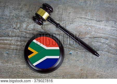 Wooden Judgement Or Auction Mallet With Of South Africa Flag. Conceptual Image.