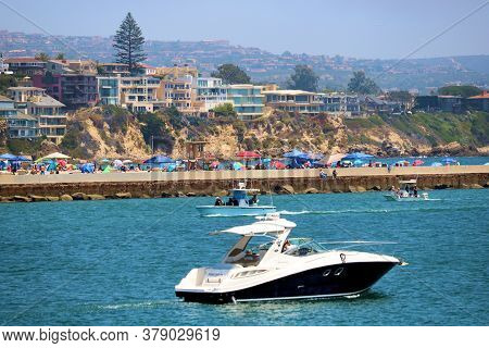 July 30, 2020 In Newport Beach, Ca:  Yachts Riding To And From The Newport Harbor With Crowds Of Peo