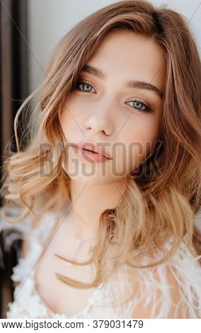 Close-up. Face Of Beautiful Young Girl With Well-groomed Clean Skin And Natural Makeup.