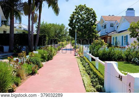 July 30, 2020 In Newport Beach, Ca:  Pathway Thru A Residential Neighborhood With Manicured Gardens
