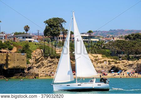 July 30, 2020 In Newport Beach, Ca:  Sail Boat Sailing Into The Newport Harbor From The Ocean With Q