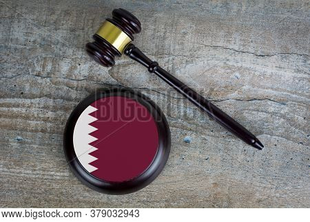 Wooden Judgement Or Auction Mallet With Of Qatar Flag. Conceptual Image.