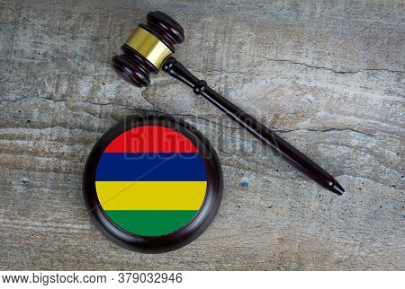 Wooden Judgement Or Auction Mallet With Of Mauritius Flag. Conceptual Image.
