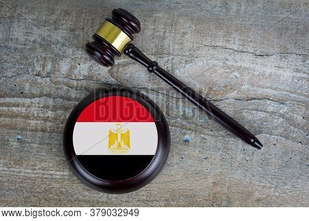 Wooden Judgement Or Auction Mallet With Of Egypt Flag. Conceptual Image.