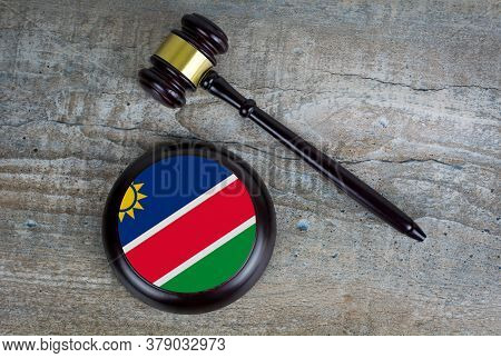 Wooden Judgement Or Auction Mallet With Of Namibia Flag. Conceptual Image.