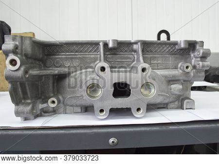 View From The Exhaust Manifold On The Head Of The Block Of A Gasoline Three-cylinder Internal Combus