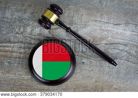 Wooden Judgement Or Auction Mallet With Of Madagascar Flag. Conceptual Image.