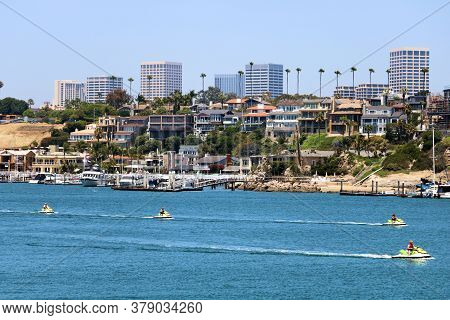 July 31, 2020 In Newport Beach, Ca:  People Jet Skiing From The Newport Harbor Out To Sea With The D