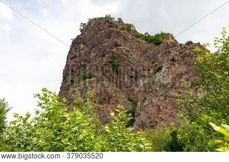 View At Rock Formation Rheingrafenstein With Green Vegetation In Foreground