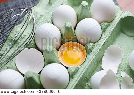 Group Of Raw White Chicken Eggs In Green Paper Tray On Wooden Table, Fresh Half Cracked Egg And Stai