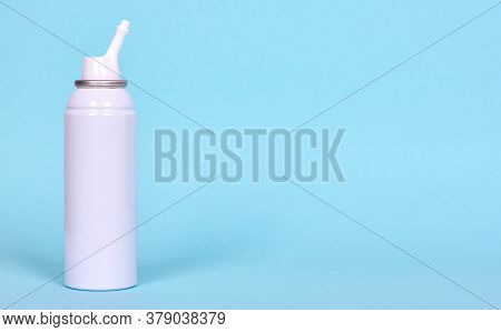 Nasal Spray Bottle, Sea Water For Cleanse. Isolated On Blue Background, Copy Space Template, Banner.
