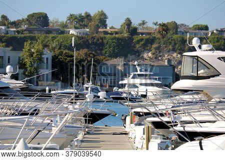 July 31, 2020 In Newport Beach, Ca:  Contemporary Luxury Boats Docked In The Newport Harbor Where Pe