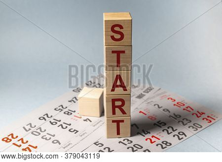 Wooden Blocks With The Word Start. Start, Start Up, New Career Or New Business, Mindset Concept.