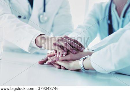 Team Of Doctors Putting Hands Together, Closeup