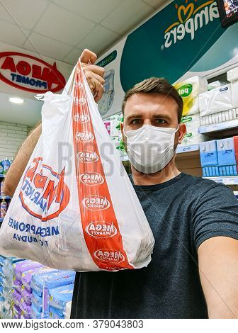 Budva, Montenegro - 01 August 2020: A Masked Man With A Bag Of Goods In A Store During The Coronavir