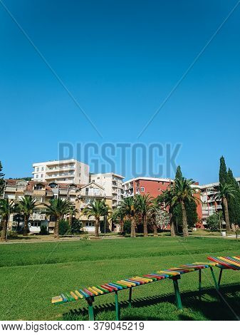 Yugoslavian Houses In The Center Of Budva In Montenegro, Next To The City Park And Green Date Palms,
