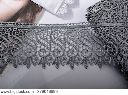 Tapes Of Gray Gentle Guipure, Beauty Lace Fabric On Light Background. Elastic Material. Using For At