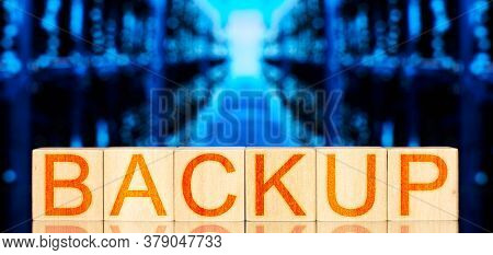 Backup. Wooden Blocks With Backup Lettering On Blue Background With Storage Servers