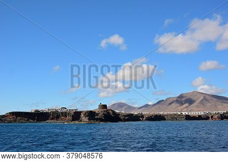 Unique Volcanic Island Lanzarote. Coastline With Old Napolionic Fort Nearby  Playa Blanca, Canary Is